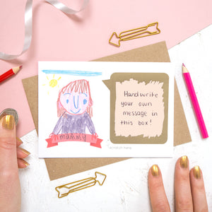 Draw your own scratch card with a hand written message of 'i love you mummy'. The card features a child like drawing of a person and the panel has been scratched off to reveal a hand written message.
