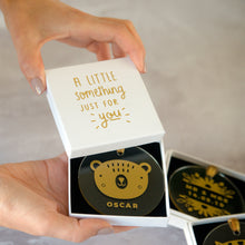 Load image into Gallery viewer, An example of the white gift box upgrade with the gold bear personalised decoration inside.