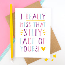 Load image into Gallery viewer, I really miss that silly face of yours card in pink, purple and blue, shot on a pink background with a yellow pencil.