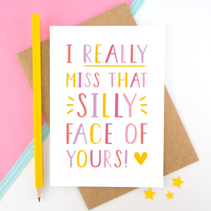 I really miss that silly face of yours card in pink, yellow and lilac shot on a pink background with a yellow pencil.