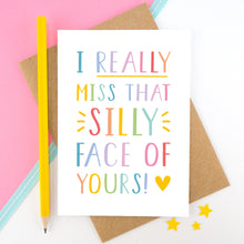Load image into Gallery viewer, I really miss that silly face of yours card in rainbow, shot on a pink background with a yellow pencil.