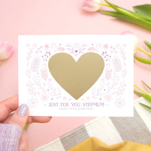 Load image into Gallery viewer, A personalised just for you stepmum scratch card showing how the card looks before the golden heart is scratched off to reveal the message. Shot on a pink background with tulips.