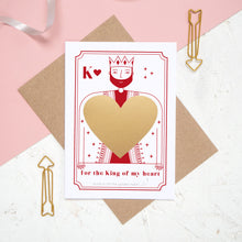 Load image into Gallery viewer, A king of my heart scratch and reveal card featuring a gold panel hiding the secret message. Shot on a pink background.