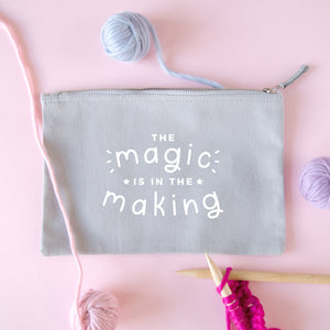 The magic is in the making medium project pouch in grey with a white print surrounded by Lauren Aston merino yarn.