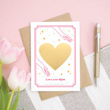 Load image into Gallery viewer, A personalised 'love you...' card before the gold heart has been scratched off. It has been shot on a pink background, with tulips and a pen for scale.