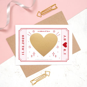 The personalised Love token scratch card after the personalised message has been covered with the gold scratch panel.