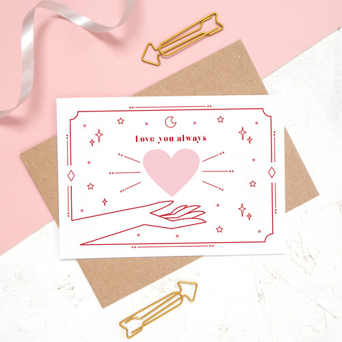 This card features the phrase 'love you always' with a heart and cosmic decor. A timeless classic for valentine's day.