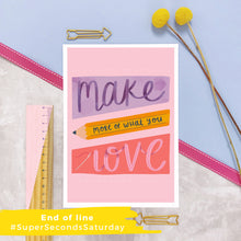Load image into Gallery viewer, Make more of what you love print with a pink background and purple, yellow and dark pink shapes filled with lettering. Photographed on a marble and lilac background