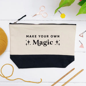 A make your own magic cotton storage bag, natural in colour with a black box bottom base photographed in a flatlay style surrounded by crochet tools.