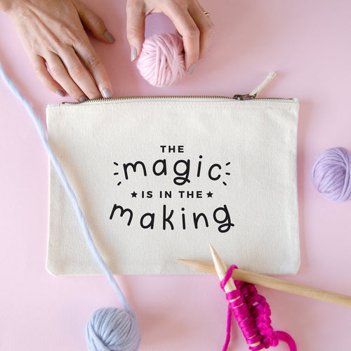 The magic is in the making large project pouch in natural with a black print surrounded by Lauren Aston merino yarn.