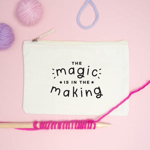 The magic is in the making medium project pouch in natural with a black print surrounded by Lauren Aston merino yarn.