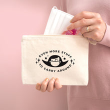Load image into Gallery viewer, Even more stuff to carry around zipped cotton pouch in natural with black text. Photographed on a pink background. Model is holding the pouch with a face mask and hand sanitiser.