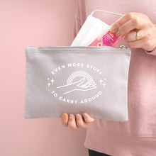 Load image into Gallery viewer, Even more stuff to carry around zipped cotton pouch in grey with white text. Photographed on a pink background. Model is holding the pouch with a face mask and hand sanitiser.