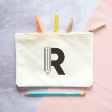 Load image into Gallery viewer, A natural cotton zipped pouch with a pencil initial R printed in black.