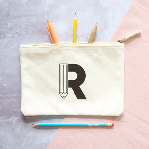 A natural cotton zipped pouch with a pencil initial R printed in black.