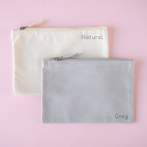 Natural and grey pouch colour choices on a pink background.