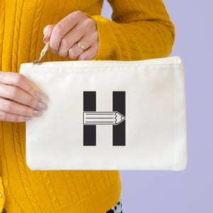 A natural cotton zipped pouch with a pencil initial H printed in black.
