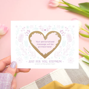 Just for you stepmum scratch card showing where your personalised message will be printed. The card is held over a pink background with tulips and stripy rug.