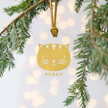 Load image into Gallery viewer, A personalised gold cat Christmas bauble decoration made from clear acrylic and hung on gold hanging cord from a Christmas tree.
