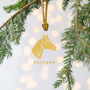 A personalised gold horse Christmas bauble decoration made from clear acrylic and hung on gold hanging cord from a Christmas tree.