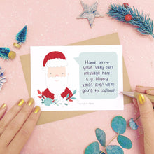 Load image into Gallery viewer, An example of a handwritten message on a personalised scratch card. Shot on a pink background with festive photo props.