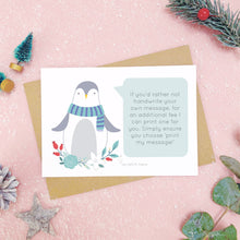 Load image into Gallery viewer, Penguin scratch card showing where you write your hidden message can be printed. Shot on a pink background, surrounded with festive christmas props in tones of green and grey.