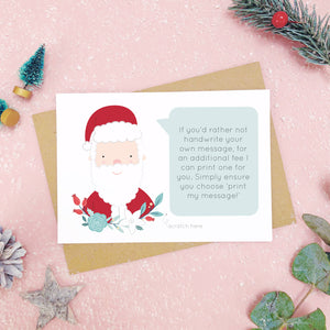 An example of a printed message on a personalised scratch card. Shot on a pink background with festive photo props.