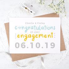 Load image into Gallery viewer, A personalised engagement card with room for the happy couples names and date the question was popped! This card has orange and blue text on a white background with a grey date.