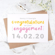 Load image into Gallery viewer, A personalised engagement card with room for the happy couples names and date the question was popped! This card has orange and pink text on a white background with a grey date.