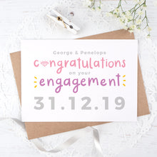 Load image into Gallery viewer, A personalised engagement card with room for the happy couples names and date the question was popped! This card has purple and pink text on a white background with a grey date.