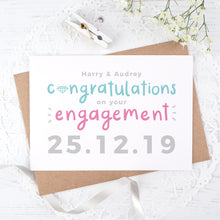 Load image into Gallery viewer, A personalised engagement card with room for the happy couples names and date the question was popped! This card has teal and pink text on a white background with a grey date.