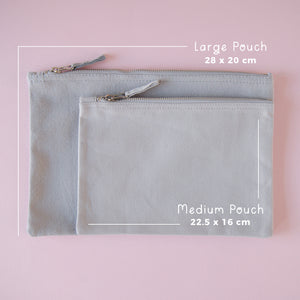Dimensions of the medium and large grey pouches on a pink background.