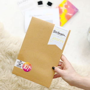The stop wishing start doing collaboration kit comes packaged in a limited edition brown envelope.