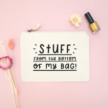 Load image into Gallery viewer, Stuff from the bottom of my bag cotton pouch in natural with black text. Shot on a pink background surrounded with dried flowers and a bottle of gold nail varnish.