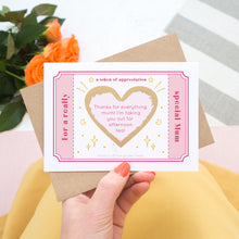 Load image into Gallery viewer, The token of appreciation scratch card showing you an example of a personalised message. The card is shot being held over a pink skirt with roses in the background. The card is pink, red and gold in colour.