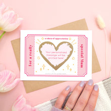 Load image into Gallery viewer, A token of appreciation scratch card showing where your printed message will appear on the front of the card. The card is shot on a pink background and with a hand bottom right.