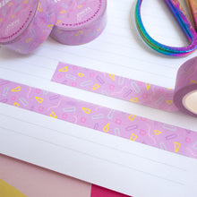 Load image into Gallery viewer, Strips of the purple confetti washi tape cut to size and stuck down in a white lined notebook.