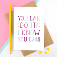 Load image into Gallery viewer, You can do it, I know you can! - Positive encouragement card photographed on a pick and white background separated with a teal ribbon. Also featuring a yellow pencil for scale. This version is in pink, purple and blue colour palette.