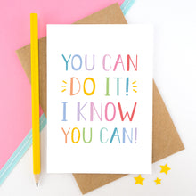 Load image into Gallery viewer, You can do it, I know you can! - Positive encouragement card photographed on a pick and white background separated with a teal ribbon. Also featuring a yellow pencil for scale. This version is in a rainbow colour palette.