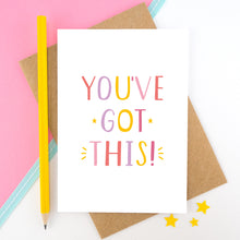 Load image into Gallery viewer, You've got this! A positive encouragement card photographed on a pink and white background with a teal ribbon and bright yellow pencil. The lettering on this card is in pinks, yellow and lilac.