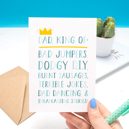 'Dad, king of: bad jumpers, dodgy d.i.y, burnt sausages, terrible jokes, dad dancing and embarrassing stories!' - Father's day card in blue with a little yellow crown.