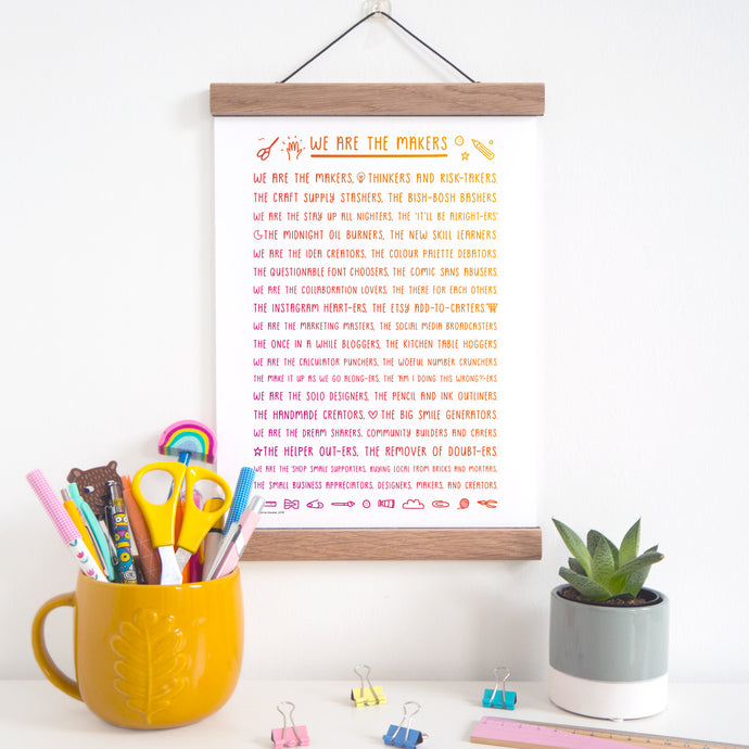 We are the makers rhyming print about what it means to be a maker in rainbow, displayed in an oak magnetic frame which is available as an add on purchase.