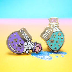 A potion bottle filled with purple shiny courage and a potion bottle filled with teal and blue, sparkly new ideas in the form of a hard enamel pin