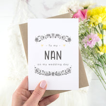 To my nan on my wedding day. A white card with grey hand drawn lettering, and a grey floral border. The image features a wedding dress and bouquet of flowers.