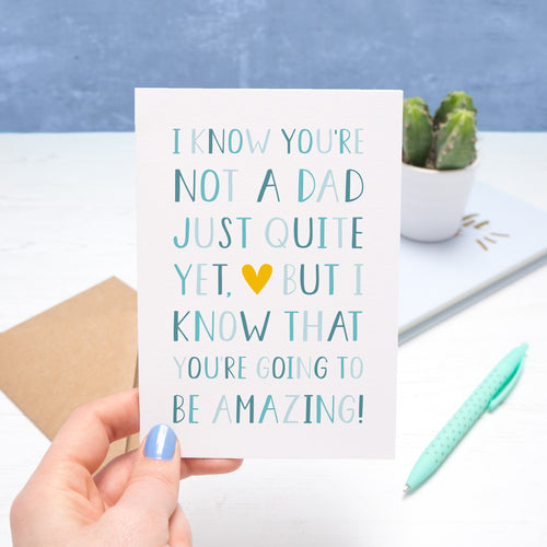 A typographic father's day card by Joanne Hawker, held on a white and blue background. The card reads
