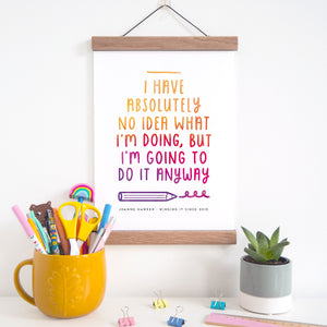 'I have absolutely no idea what I'm doing but I'm going to do it anyway' print personalised with your name and the phrase 'winging it since X date'. Image shows the print inside of a magnetic oak frame.