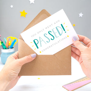 'You only went and passed! Congratulations!' A congratulations card for someone who has completed their exams recently. It features grey text with the word 'passed' in a hand lettered font with varying tones of blue and yellow stars.