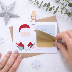 Personalised Santa secret message Christmas scratch card with the gold scratch and reveal panel being applied.