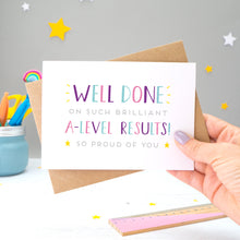 Load image into Gallery viewer, 'Well done on such brilliant A-Level Results! So proud of you. A congratulations card featuring my hand drawn type in varying shades of pink, purple and blue, with a bright yellow stars around the grey text.