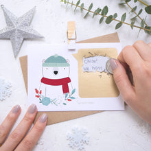 Load image into Gallery viewer, Personalised polar bear secret message Christmas scratch card being scratched off with a coin.